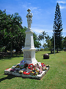 Flower wreaths on statue in ANZAC Park, Port Douglas during ANZAC Day Parade 2009. <br />
