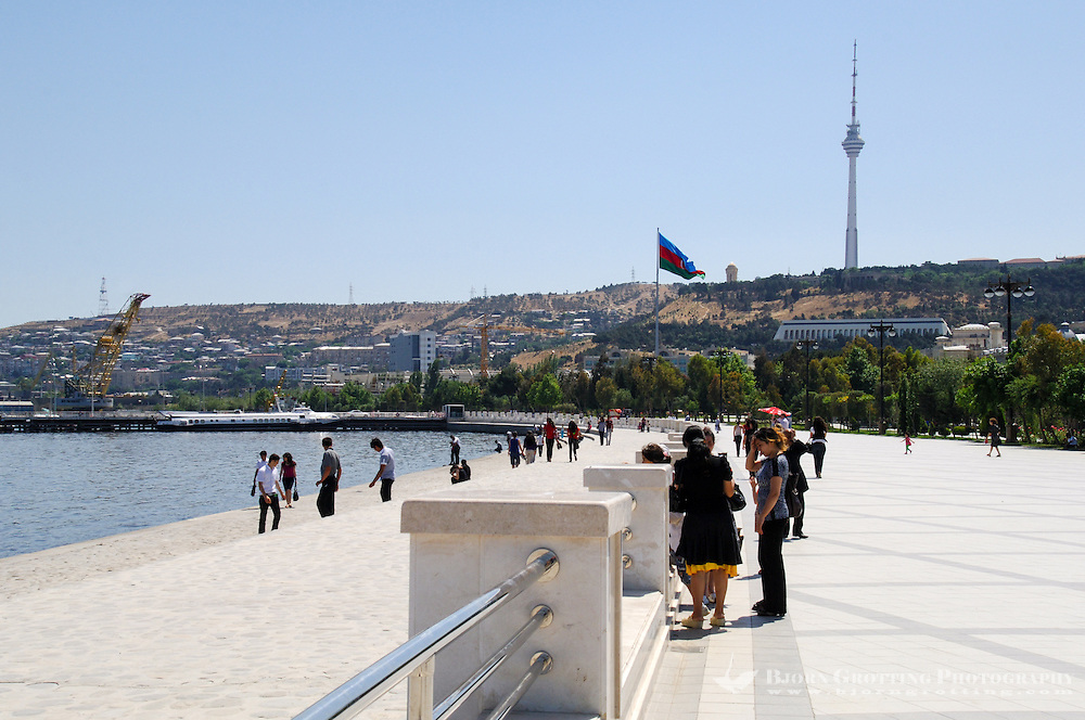Azerbaijan, Baku. Baku Boulevard is a promenade that runs parallel to Baku's seafront. Baku TV Tower in the background, the tallest building in the country, 310 metres.