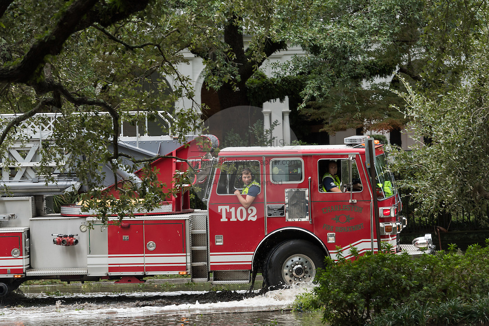 A fire truck rolls through flood waters on South Battery Street in historic downtown after Hurricane Matthew passed through causing flooding and light damage to the area October 8, 2016 in Charleston, South Carolina. The hurricane made landfall near Charleston as a Category 2 storm but quickly diminished as it moved north.