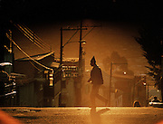 Man crossing the street at sunset in Potosi department, Bolivia