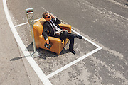 scene of businessmen who parks his armchair and call with old phone