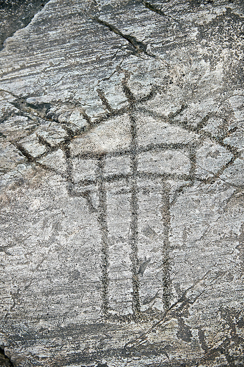 Prehistoric Petroglyph, rock carving, of a hut raied on wooden ploes carved by the Camunni people in the ,iddle to late iron age between  900-1200 BC, Rock no 18, Seradina II area , Seradina-Bedolina Archaeological Park, Valle Comenica, Lombardy, Italy .<br /> <br /> Visit our PREHISTORY PHOTO COLLECTIONS for more   photos  to download or buy as prints https://funkystock.photoshelter.com/gallery-collection/Prehistoric-Neolithic-Sites-Art-Artefacts-Pictures-Photos/C0000tfxw63zrUT4<br /> If you prefer to buy from our ALAMY PHOTO LIBRARY  Collection visit : https://www.alamy.com/portfolio/paul-williams-funkystock/valcamonica-rock-art.html
