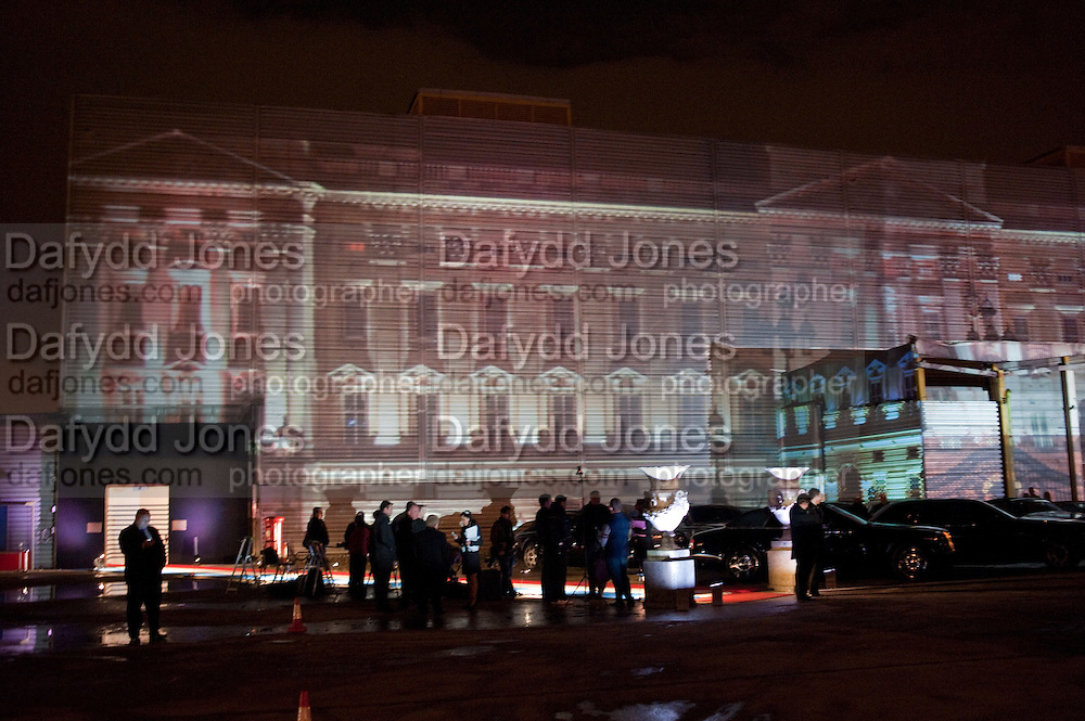 BUCKINGHAM PALACE PROJECTED ONTO BUILDING IN SOUTH LONDON. DESIGNED BY JEAN-PAUL GAULTIER,  Grey Goose character and cocktails. The Elton John Aids Foundation Winter Ball. off Nine Elms Lane. London SW8.  chef Marcus Wareing was in charge of dinner.30 October 2010. -DO NOT ARCHIVE-© Copyright Photograph by Dafydd Jones. 248 Clapham Rd. London SW9 0PZ. Tel 0207 820 0771. www.dafjones.com.