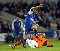 SPORTSBEAT 01494 783165<br /> PICTURE ADY KERRY .<br /> MILLWALL VS CARDIFF CITY<br /> MILLWALL'S NICK CHADWICK  CHALLENGES CARDIFF CITY'S RICHARD LANGLEY DURING THEIR DIVISION 1 MATCH AT THE NEW DEN, 7TH APRIL 2004.
