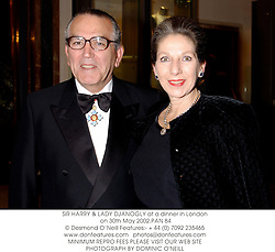 SIR HARRY & LADY DJANOGLY at a dinner in London on 30th May 2002.PAN 84