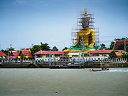02 AUGUST 2018 - PAK KRET, NONTHABURI, THAILAND: A giant statue of the Buddha under construction at Wat Bang Chak, across the Chao Phraya River from Ko Kret. Ko Kret (also spelled Koh Kret) is a small island in the Chao Phraya River in Nonthaburi province north of Bangkok. It is about 2 km long and 1 km wide. It has seven main villages, the largest and most populous being Ban Mon. Ko Kret was created in 1722 when a canal was dug in the Chao Phraya River to bypass a bend. Most of the people on the island are ethnically Mon, from the hills of western Thailand and eastern Myanmar (Burma). The island is popular as a weekend daytrip from Bangkok. The island is famous for the Mon style pottery made on the island.      PHOTO BY JACK KURTZ