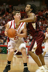01 January 2006..Michael Vandello grimices as he gets fouled by Randal Falker...The Southern Illinois Saluki's chewed up the Illinois State Redbirds with 37 points in the 2nd half to beat the birds with a final score of 65-52.  An audience of just over 7500 watched the in Redbird Arena on the campus of Illinois State University in Normal Illinois.....
