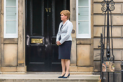 Prime Minister and Conservative Leader, Boris Johnson visits Bute House to meet First Minister of Scotland, Nicola Sturgeon. Earlier in the day, Johnson announced £300m of funding for projects to boost the economy in Scotland, Wales and Northern Ireland.<br /> <br /> Pictured: FM Nicola Sturgeon waits for the Prime Minister to arrive