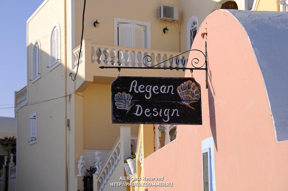 "Decor shop ""Aegean Design"" sign in Santorini"