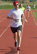 Central Valley, New York - Michael Williams finishes the Woodbury Country Ramble race on Aug. 26, 2012.