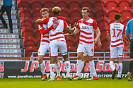 Kieran Sadlier of Doncaster Rovers (22) scores a goal and celebrates with Mallik Wilks of Doncaster Rovers (7) and John Marquis of Doncaster Rovers (9) to make the score 1-0 during the EFL Sky Bet League 1 match between Doncaster Rovers and Coventry City at the Keepmoat Stadium, Doncaster, England on 4 May 2019.