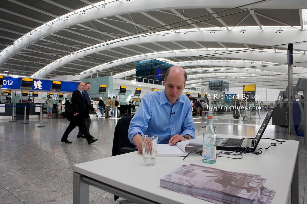 Heathrow writer-in-residence, Alain de Botton writes his airport novel in Departures at Heathrow Airport's Terminal 5.