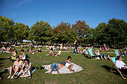 People out enjoying the unseasonally hot weather as a summertime heat wave hits London and the UK in what should be Autumn. Summer prolonged in a heatwave which results in a packed Hyde Park as families and friends try to soak up the last rays of sunshine and warmth in this Indian Summer.