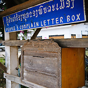 "A ""People's Complain Letter Box"" or feedback or complaint box on the street in downtown Luang Namtha in northern Laos."