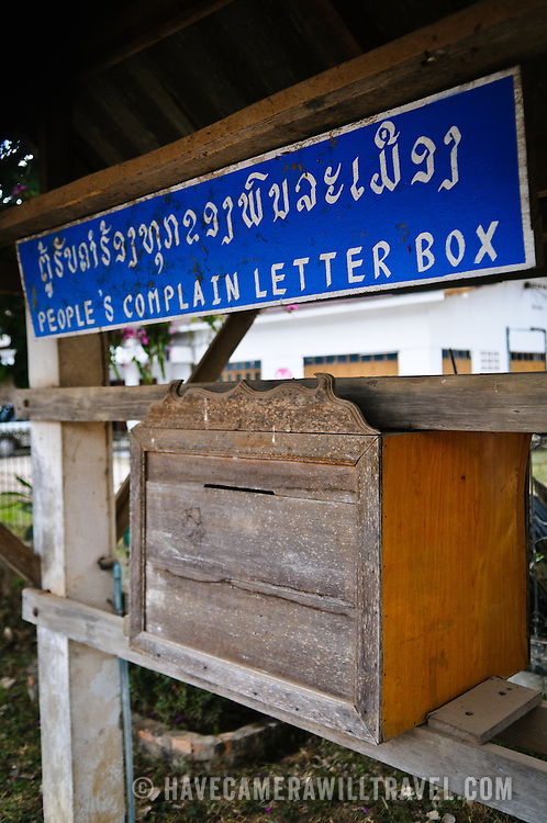 """A """"People's Complain Letter Box"""" or feedback or complaint box on the street in downtown Luang Namtha in northern Laos."""