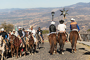 Mexican cowboys process from the Cristo Rey shrine on top Cubilete Mountain at the end of the annual Cabalgata de Cristo Rey pilgrimage January 6, 2017 in Guanajuato, Mexico. Thousands of Mexican cowboys take part in the three-day ride to the mountaintop shrine of Cristo Rey which concludes on the Day of Epiphany.