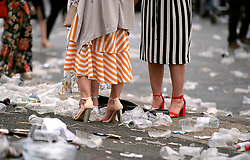 Female racegoers are surrounded by rubbish during Ladies Day of the 2018 Randox Health Grand National Festival at Aintree Racecourse, Liverpool.