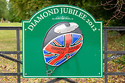 Sign for Diamond Jubilee 1952-2012 on gate entrance to public park, Netheravon, Wiltshire, England, UK