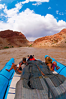 A Wilderness River Adventures motorized pontoon rafting through Cataract Canyon, the Colorado River in Canyonlands National Park, Utah, USA.