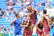 QPR's Karl Henry (20) heads away under pressure from Cardiff's Frederic Gounongbe (behind). EFL Skybet championship match, Cardiff city v Queens Park Rangers at the Cardiff city stadium in Cardiff, South Wales on Sunday 14th August 2016.<br /> pic by Carl Robertson, Andrew Orchard sports photography.
