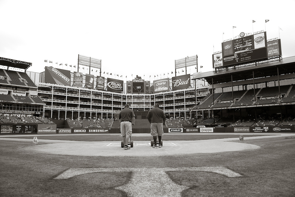 Grounds crew marking field pre-game. Seattle Mariners at Texas Rangers. Photographed at Rangers Ballpark In Arlington in Arlington, Texas on Sunday, April 11, 2010. Photograph © 2010 Darren Carroll.