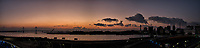Yokohama Skyline Panorama at Dawn from the Deck of the MV World Odyssey while Docked at the Osanbashi Pier. Composite of six images taken with a Fuji X-T1 camera and 23 mm f/1.4 lens (ISO 200, 23 mm, f/2.8, 1/60 sec). Raw images processed with Capture One Pro and the composite created using AutoPano Giga Pro.