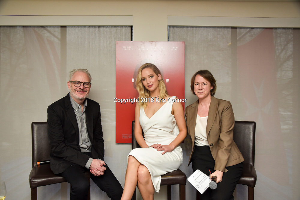 """Director Francis Lawrence and actress Jennifer Lawrence of 20th Century Fox's new movie """"Red Sparrow,"""" speak with moderator NPR's Elizabeth Blair during a luncheon at Cafe Milano in Washington DC on February 16th, 2018. (Photo by Kris Connor for 20th Century Fox)"""