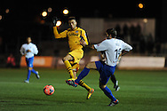 Christian Jolley of Newport county is tackled by Braintree's Dean Wells (r) .FA cup with Budweiser, 1st round replay, Newport county v Braintree Town at Rodney Parade in Newport, South Wales on Tuesday 19th November 2013. pic by Andrew Orchard, Andrew Orchard sports photography,