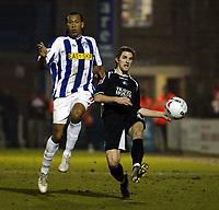 Photo: Chris Ratcliffe.<br /> Colchester United v Swansea City. LDV Vans Trophy. 14/03/2006.<br /> Chris Iwelumo (L) of Colchester tackles Sam Ricketts of Swansea