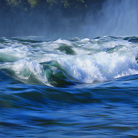 """""""Niagara's Edge""""<br /> <br /> Gorgeous blue shades combined with white as the waters of the Niagara River goes over the edge!"""