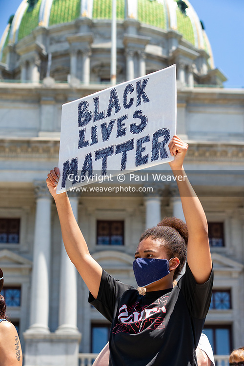 A protester holds a black lives matter sign in front of the Pennsylvania State Capitol. Hundreds of people gathered in Harrisburg to protest the police killing George Floyd in Minneapolis.