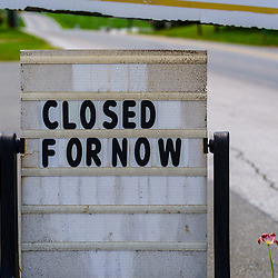 White Horse, PA / USA - May 3, 2020: A closed for now sign at a shop in south central Pennsylvania.