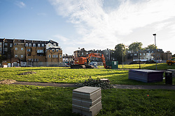 London, UK. 14th August, 2021. A view of works by Southwark Council on Peckham Green to develop it as public housing. Peckham Green is a 1.4-acre public park off Peckham High Street, one of the most polluted roads in London, in a borough which is ranked fifth-worst in London and eighth-worst in the UK for easy access to green space, and local residents and campaigners have been protesting that they were not consulted by Southwark Council in relation to its plans.