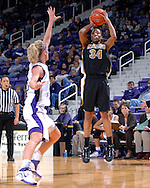 Missouri guard Tiffany Brooks (34) puts up a shot over Kansas State's Danielle Zanotti during the first half at Bramlage Coliseum in Manhattan, Kansas, January 13, 2007.  K-State beat the Tigers 81-66.