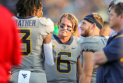 Sep 11, 2021; Morgantown, West Virginia, USA; West Virginia Mountaineers quarterback Garrett Greene (6) talks to players along the sidelines during the second quarter against the Long Island Sharks at Mountaineer Field at Milan Puskar Stadium. Mandatory Credit: Ben Queen-USA TODAY Sports