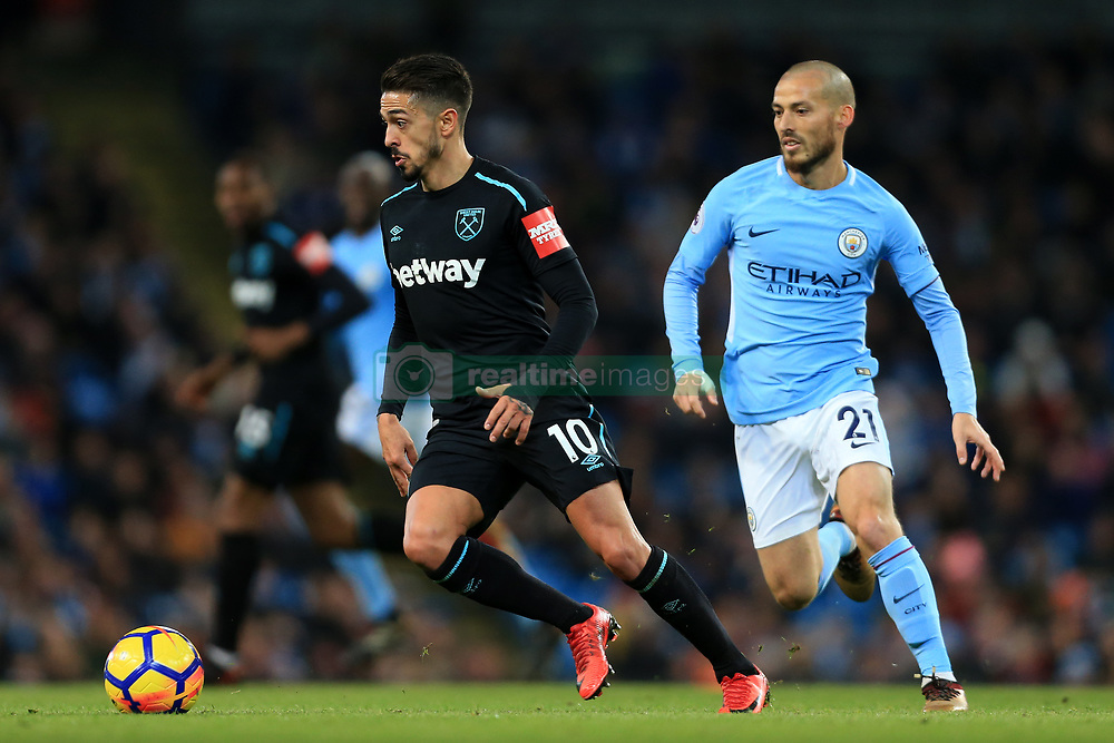 3rd December 2017 - Premier League - Manchester City v West Ham United - Manuel Lanzini of West Ham battles with David Silva of Man City - Photo: Simon Stacpoole / Offside.