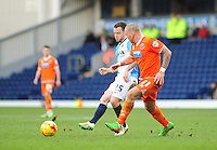 Blackburn Rovers' Jay Spearing gets a pass away under pressure from Blackpool's Jamie O'Hara<br /> <br /> Photographer Andrew Vaughan/CameraSport<br /> <br /> Football - The Football League Sky Bet Championship - Blackburn Rovers v Blackpool - Saturday 21st February 2015 - Ewood Park - Blackburn<br /> <br /> © CameraSport - 43 Linden Ave. Countesthorpe. Leicester. England. LE8 5PG - Tel: +44 (0) 116 277 4147 - admin@camerasport.com - www.camerasport.com