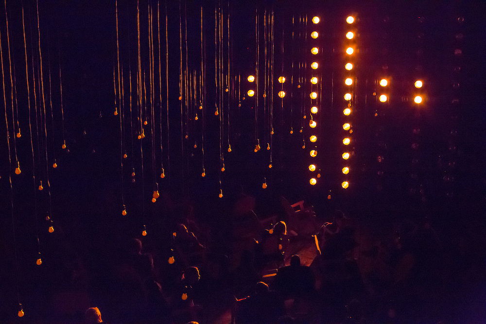 "Lights form the shape of a cross in Samuel Beckett's ""All That Fall"", directed by Gavin Quinn, at BAM's Fishman Space."
