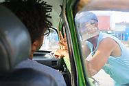 A man haggles for taxi rides to Guardalavaca<br /> <br /> Holguin, Cuba