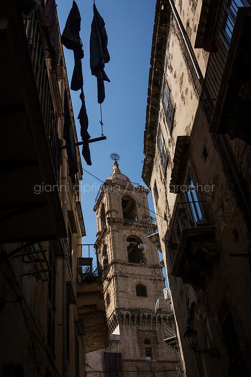 PALERMO, ITALY - 22 MARCH 2017: The tower of Palazzo Marchesi, where a a mikveh - or Jewish ritual bath - was found below the courtyard, is seen here in the Giudecca, the ancient Jewish quarter of Palermo, Italy, on March 22nd 2017. Later in the 16th century, Palazzo Marchesi housed the offices of the Inquisition.<br /> <br /> In 1492, Sicily's Jews were banished from the island, the victims of a Spanish edict that forced thousands to leave and others to convert to Roman Catholicism. On Jan. 12, exactly 524 years to the day that the edict gave as a deadline for Sicily's Jews to depart, Palermo's archbishop, Corrado Lorefice, granted the emerging community the use of a deconsacrated oratory, to be transformed into Palermo's first stable synagogue in five centuries.  The synagogue will be located in what once was known as the Giudecca, Palermo's ancient Jewish quarter