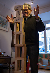 Retired product designer turned toy maker, whose many innovations became iconic household names Tom Karen is photographed with toys he created from recycled materials at his home in Cambridge, UK.<br /> PICTURED: Tom demonstrates his Big Brix building blocks. <br /> Cambridge, March 01 2018.