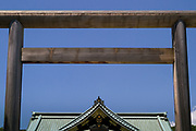 A torii gate in front of the roof of Yasukuni Shrine in Kudanshita, Tokyo, Japan. Friday June 2nd 2017