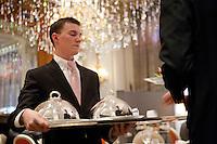 luncheon service at Restaurant Alain Ducasse, Hotel Plaza Athenee, Paris...Photograph by Owen Franken