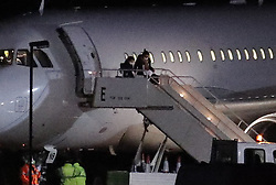 © Licensed to London News Pictures. 02/02/2020. Brize Norton, UK.  Passengers evacuated from Wuhan in China disembark at RAF Brize Norton in Oxfordshire. On Friday 83 Britons were flown from the centre of the coronavirus outbreak to RAF Brize Norton and then transported to quarantine for 14 days at Arrowe Park Hospital on the Wirral. Photo credit: Peter Macdiarmid/LNP