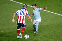 Atletico de Madrid´s Arda Turan (L) and Malmo´s Ricardinho during Champions League soccer match between Atletico de Madrid and Malmo at Vicente Calderon stadium in Madrid, Spain. October 22, 2014. (ALTERPHOTOS/Victor Blanco)
