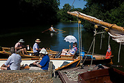 A tourist crew ready themselves for their onward journey at Gay's Staithe on Barton Broad, a Norfolk Wildlife Trust Nature Reserve. Gay's Staithe lies along the western arm of Barton Broad known as Limekiln Dyke, once a calling point for wherriy boats carrying corn, coal and reeds for the thatching industry and named after Billy Gay whose trading wherry business operated from here.