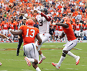 Richmond Spiders quarterback Michael Strauss (3) throws a touchdown pass between Virginia Cavaliers linebacker Daquan Romero (13) and Virginia Cavaliers linebacker LaRoy Reynolds (9) during the 2nd half of an NCAA football game against the Virginia Cavaliers Saturday September, 1, 2012 at Scott Stadium in Charlottesville, Va. Virginia defeated Richmond 43-19.  Photo/The Daily Progress/Andrew Shurtleff