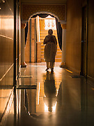 "08 FEBRUARY 2015  BANGKOK, THAILAND: A Sikh woman walks between rooms used for the study of Sikh texts in Gurdwara Siri Guru Singh Sabha, the Sikh temple in Bangkok. Thailand has a small but influential Sikh community. Sikhs started coming to Thailand, then Siam, in the 1890s. There are now several thousand Thai-Indian Sikh families. Gurdwara Siri Guru Singh Sabha was established in 1913. Construction of the current building, adjacent to the original Gurdwara (""Gateway to the Guru""), started in 1979 and was finished in 1981. The Sikh community serves a daily free vegetarian meal at the Gurdwara that is available to people of any faith and background.    PHOTO BY JACK KURTZ"