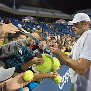 August 21, 2014, New Haven, CT:<br /> Andy Roddick signs autographs during the Men's Legends Event on day seven of the 2014 Connecticut Open at the Yale University Tennis Center in New Haven, Connecticut Thursday, August 21, 2014.<br /> (Photo by Billie Weiss/Connecticut Open)