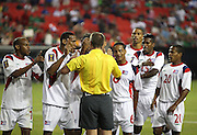 ATLANTA, GA - JULY 20:  Members of the Cuba National Soccer Team argue with referee Mark Geiger (center) after a call that allowed a penalty kick attempt during the CONCACAF Gold Cup quarterfinal game against Panama at Georgia Dome on July 20, 2013 in Atlanta, Georgia.  (Photo by Mike Zarrilli/Getty Images)